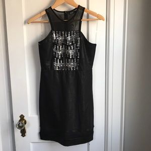 Black bodycon dress with front embellishment